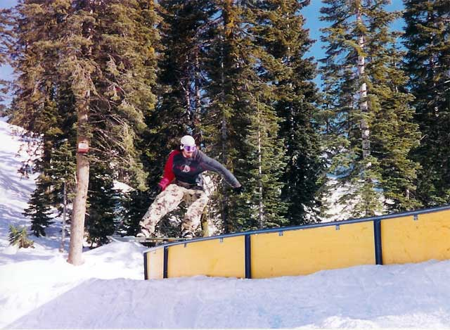 "Jack the son charging the ""s"" rail at Milk Money Terrain Park '04"
